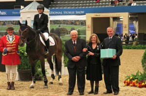 Victoria Colvin receives her award from Harry de Leyer, rider of Hall of Fame horse Snowman, and George Morris, President of the Show Jumping Hall of Fame