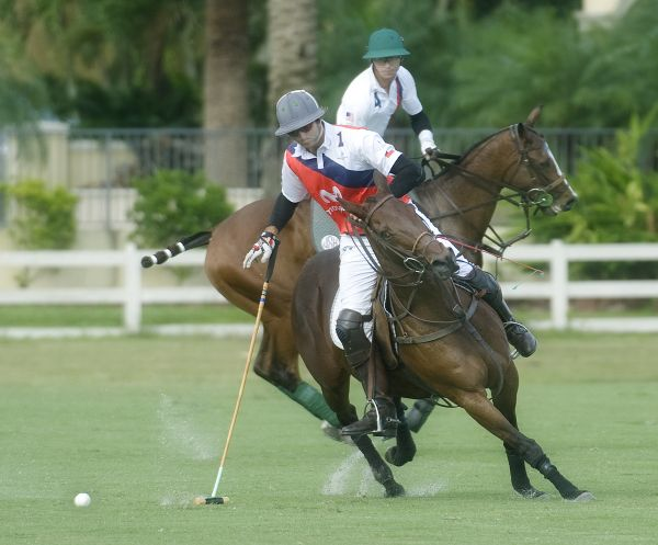 Chile's Matias Vial (1) and his horse turn into a shot with Team USA's Jeff Hall (4) defending. Photo by Scott Fisher