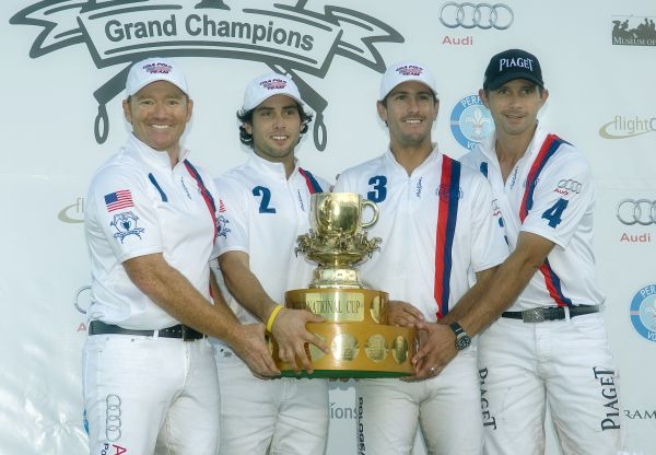We Are The Champions, Team USA teammates Marc Ganzi (1), Carlitos Gracida (2), Nic Roldan (3) and Jeff Hall (4) and the USPA International Cup. Photo by Scott Fisher