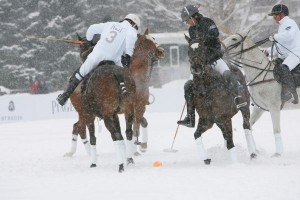 Piaget teammates Gonzalito Pieres (3) and Marc Ganzi (1) battle Nacho Figueras (3) of St. Regis for the ball. Photo by Gary Hubbell