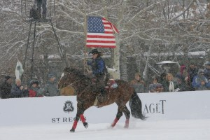 Wounded Warriors Horse brings flag bearer out to the arena for pre-game ceremony. Photo by Gary Hubbell