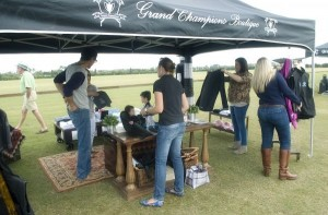 Fans check out the latest in polo fashion at the Grand Champions Boutique. Photo by Scott Fisher
