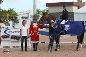 Lauren Hough and Böckmanns Lazio in their winning presentation with Lauren Tisbo of Suncast®, ringmaster Gustavo Murcia, and owner Karina Rotenberg