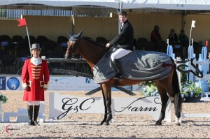 Shane Sweetnam (pictured aboard borrowed mount, Ashley Baker's HH Carotino) in his winning presentation with ringmaster Gustavo Murcia