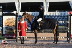 Tiffany Foster, mounted on Victor, is presented as the winner of the $34,000 Ruby et Violette WEF Challenge Cup Round III – Section B by ringmaster Gustavo Murcia at the FTI Consulting Winter Equestrian Festival in Wellington, FL. Photo by Sportfot