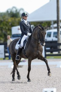 Silvia Rizzo and her Lusitano stallion Sal half-pass in the Grand Prix . Photo by Susan J. Stickle.