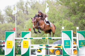 Todd Minkus and Quality Girl on their way to the win in the $50,000 CSI2* Grand Prix during the 2013 Live Oak International. (Photo courtesy of Mark Astrom)