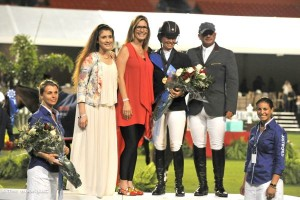 Photo Credit: Beezie Madden produced a quick and tidy double-clear effort with Coral Reef Via Volo to win the 2014 $200,000 Gene Mische American Invitational. Pictured here with G & C Farm for the presentation. All Photos By: V.Valenti/The Book LLC. Photograph may be used only in relation to this PMG press release.