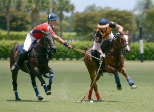 Kris Kampsen of Palm Beach Polo tries to avoid the hook of Pancho Eddy of Pony Express. Photo by Scott Fisher