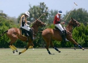 Palm Beach Polo's Glenn Straub retains possession of the ball despite defense from Justin Daniels of Pony Express. Photo by Scott Fisher