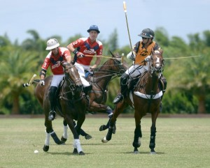 Pony Express teammates Tomas Goti and Pancho Eddy try to mount an offensive attack with Carlos Gracida Jr. of Palm Beach Polo defending. Photo by Scott Fisher