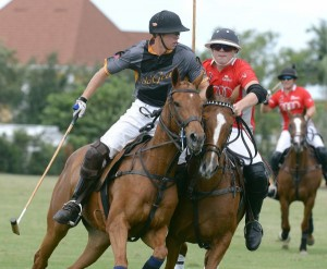Matias Gonzalez of Audi tries to bump Alejandro Gonzales of Polo Gear out of the play. Photo by Scott Fisher