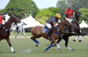 Joey Casey of Polo Gear drives downfield between Audi defenders Lucas Lalor and Matias Gonzalez. Photo by Scott Fisher