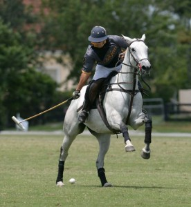 Guille Aguero of Polo Gear all alone with the ball downfield. Photo by Scott Fisher