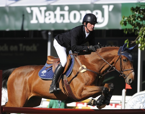 Darragh Kenny of IRL riding Picolo during the Encana Cup at the Spruce Meadows National 2014.