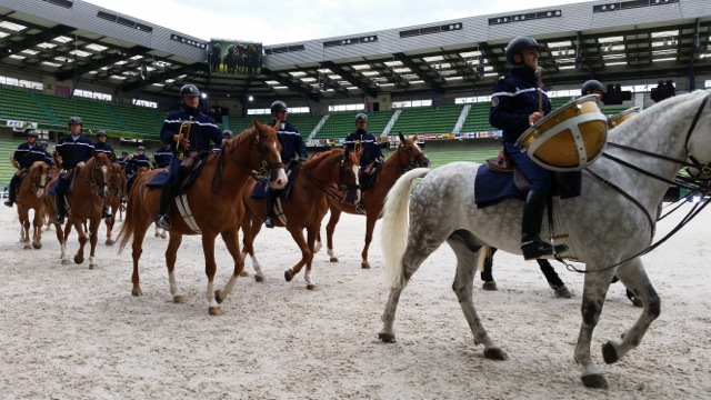 The equestrian marching band practicing for the opening ceremony.