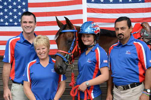 A crew member for the US Endurance Team tends to My Wild Irish Gold, owned by Team veteran Valerie Kanavy and ridden by Kelsey Russell.