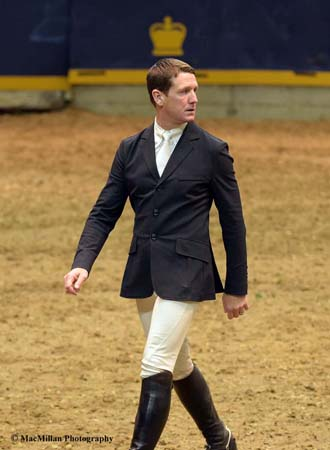 Photo 2 – U.S. Olympic rider McLain Ward walking the course for the $75,000 Big Ben Challenge jumper class sponsored by Hudson's Bay Company. He rode HH Azur owned by Double H Farms to win the class. Photo by Kim MacMillan/MacMillan Photography