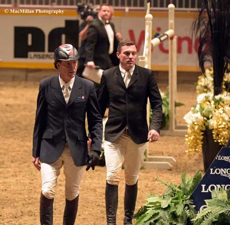 "Photo 9 – Canadian jumper rider stars Ian Millar (foreground) and Chris Sorenson on their course walk before the $75,000 Big Ben Challenge at the 2015 Royal Winter Fair. Millar is known affectionately as ""Captain Canada"" having ridden in ten Olympic Games representing Canada thus far.Photo by Kim MacMillan/MacMillan Photography"