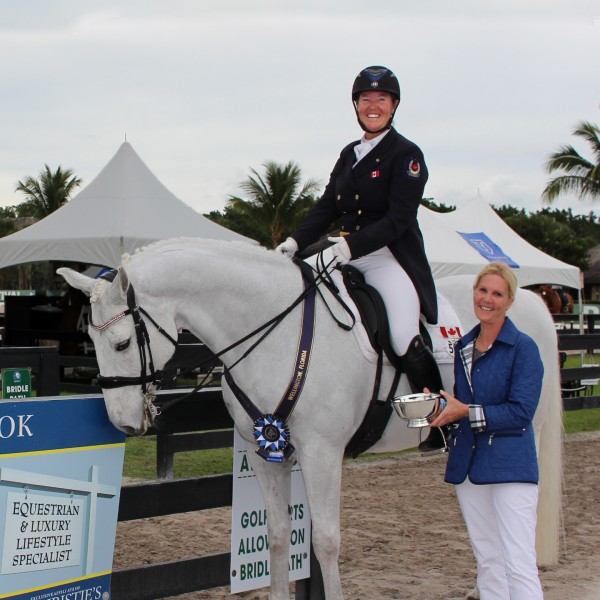 Ann-Louise Cook presents Jacqueline Brooks with the People's Choice Award at the first competition of the 2016 Adequan Global Dressage Festival. (PHOTO CREDIT: Cora Causemann )
