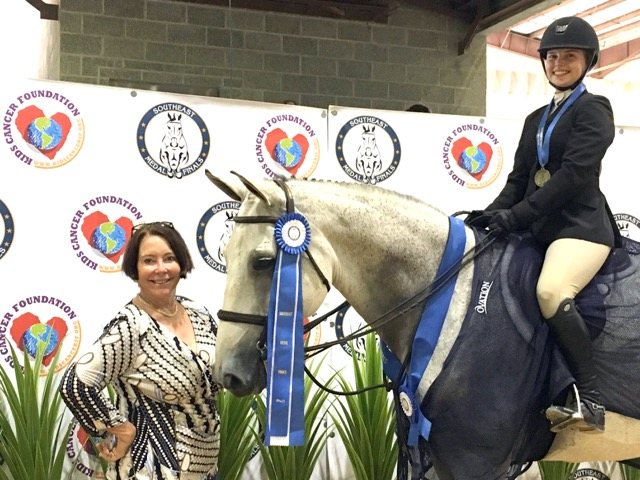 Phoebe Alwin, winner Junior Medal Finals, with trainer Jane Fennessy