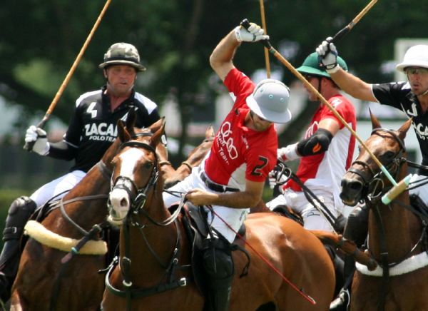 Audi's Nico Pieres goes after the ball with Zacara's Mike Azzaro and Magoo LaPrida defending and Audi teammate Jeff Hall backing up his teammate. Photo credit Alex Pacheco.