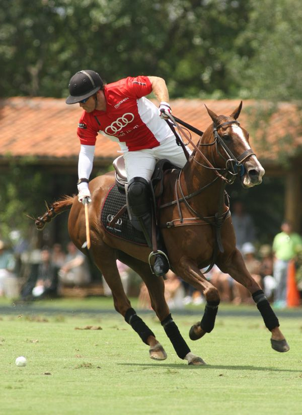 Audi team captain Marc Ganzi going for the ball while playing with a broken right thumb and protective white sleeve on right arm. Photo credit Alex Pacheco.