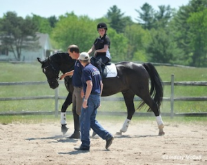 Coaches Kai Handt and Wes Dunham demonstrate working together with rider Sydney Collier and horse Wentworth Photo by Lindsay McCall