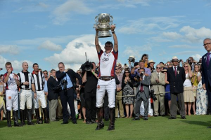 England's Luke Tomlinson hoists the Westchester Cup toward the crowd after England's sudden death overtime victory over the U.S. Photos courtesy of Audi International