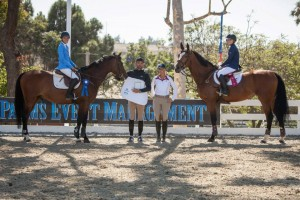Sophie and Katie finish first and second in the Black Star Equestrian Children's Jumper Classic at Huntington Beach Surf Classic. They finished less than a tenth of a second apart.