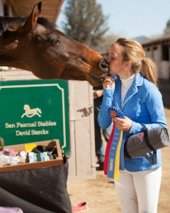 Sophie St. Clair and her horse Sjapoo sharing a sweet moment.