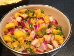 Mango salsa for adding brightness to fish tacos. Can also be served by itself for a new accompaniment to chips.