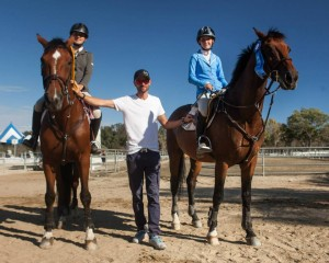 Trainer David Sterckx with Sophie St.Clair and teammate Julia Otter.
