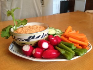 Roasted red pepper hummus enjoyed with vegetables.