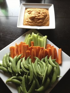 Roasted red pepper hummus plated and ready for enjoyment at your next social gathering.