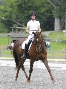 Phyllis LeBlanc of Harbor Sweets/Dark Horse Chocolates riding her Oldenburg gelding Chiron.
