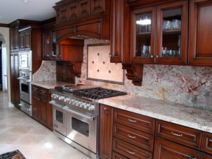A finished kitchen by Diane Barber Designs incorporates durable flooring and countertops.