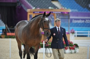 Kai Handt with his horse NTEC Richter Scale (ridden by Jonathan Wentz) preparing for the trot up at the 2012 London Paralympics. Photo (C) Lindsay Yosay McCall