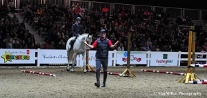 15-Educational clinics for show jumping, dressage and eventing took place in the President's Choice Animal Theatre arena. Here show jumper Hyde Moffatt explains the finer points of competing over fences.