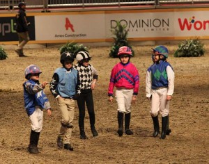 "The Grand National Shetland Pony racing jockeys practicing their ""cool"" Photo by Shelley Higgins/MacMillan Photography"