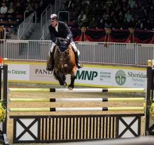 Winning the opening round of the Greenhawk Canadian Show Jumping Championships on the first night of the Royal Horse Show was the 13-year- old Dutch Warmblood gelding Star Power, owned by Team Works and ridden by Ian Millar of Perth, Ontario. Photo by Shelley Higgins/MacMillan Photography