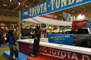 36-Tossing a ball into the back of a Toyota truck was a way for kids to win fun prizes.