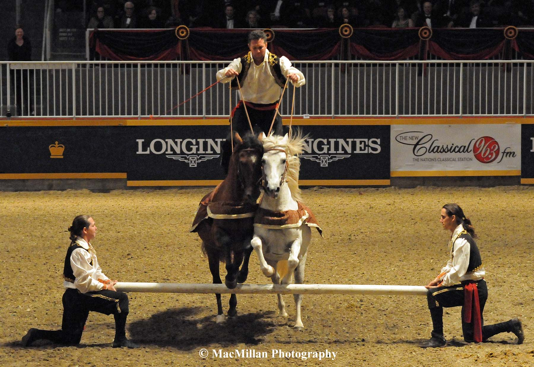 Photo 32 - The Cavallo troop member and his horses take a jump. Photo by Kim MacMillan/MacMillan Photography