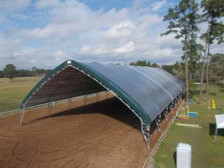 The new Pavilion Building has no end walls or sidewalls, creating a covered, outdoor environment that horses absolutely love