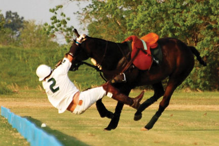 Bryan Middleton takes a spill in the Houston Polo Clubs Governors Cup, Photo by Rebecca Bollenbach