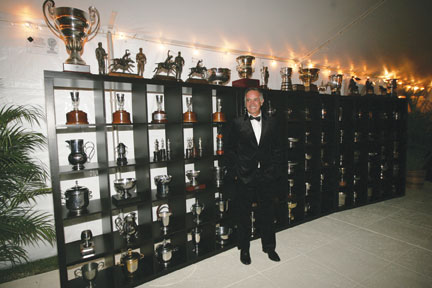 A man and his trophies - Carlos Gracida standing in front of an impressive display of just some of the trophies he has won around the world - part of a one night exhibit at the Museum set up specially for his induction into the Hall of Fame