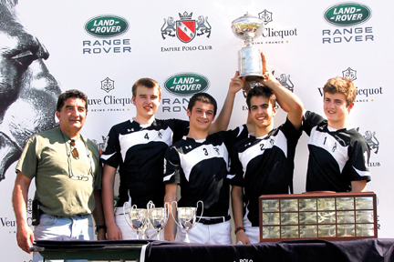 Natania proved what a difference a year makes as Connor Deal, Wyatt Harlow, Drew Peterson (alternate) and Kamran Pirasteh ripped through the season. The Warrenton, Virginia-based team earned a slot in the national finals tournament with their decisive Southeast Regionals victory (24-13) in a hotly contested match in February against Cowtown Work To Ride, the defending Open National Interscholastic champions. In March the Natania team, their coach Amir Pirasteh, and a bunch of Natania supporters flew to Indio, California where Empire Polo Club hosted the national championship tournament. In the championship match, Natania earned the national title with a 14-9 victory over Eldorado (Jake Brumby, Scott Cunningham and Jacob Deutsch). USPA Open National Interscholastic Champions Natania: (left to right) coach Amir Pirasteh, Drew Peterson (alternate) and All Star Players (voted by their peers) Wyatt Harlow, Kamran Pirasteh and Connor Deal.  Photo by Mina Pirasteh