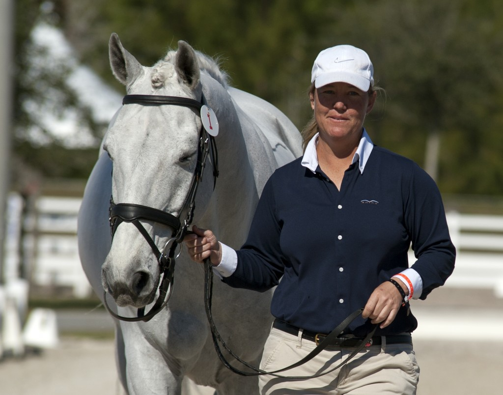 "A relaxed Jacqueline Brooks and ""Goose"" under the Florida sun in the jog at the 2013 World Dressage Masters competition.  Photo by Kim MacMillan/MacMillan Photography"