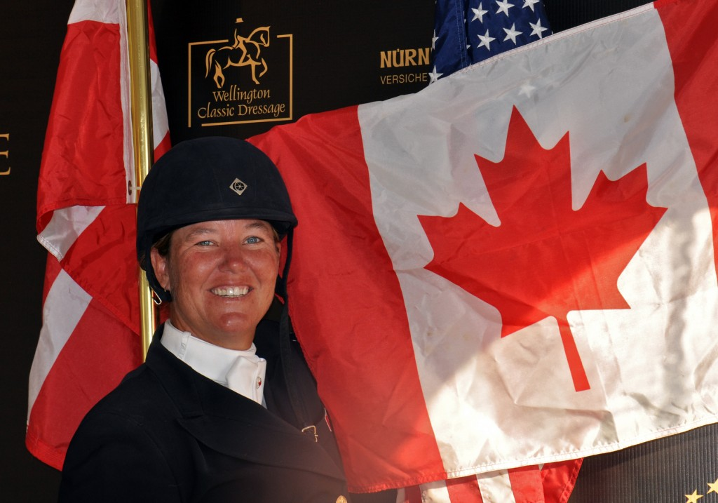 Oh, Canada! Jacqueline Brooks shows national pride following her great finish with D-Niro at the 2013 World Dressage Masters. Photo by Shelley Higgins/MacMillan Photography