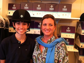 Jack wearing his new Charles Owen helmet, with April Matthews the manager of the Beval Saddlery mobile unit.